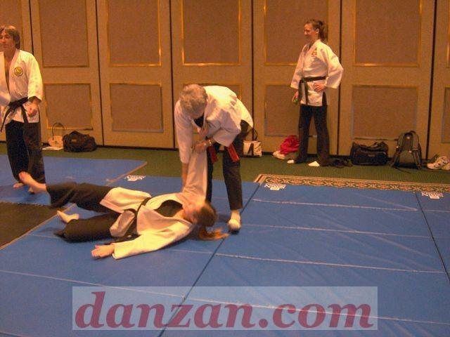 Prof. Jane Carr does a promotional throw on Cara Parmigiani, of Mountain Storm Dojo.