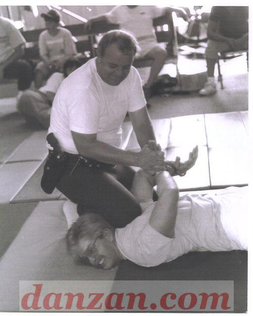 This picture shows Dave (David) Martin demonstrating an arrest technique on Robin Martin (not a relative) at a seminar in Lake C